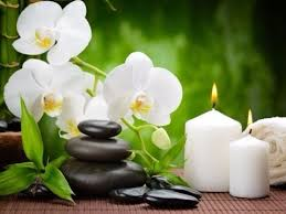 hot stones and lotus flowers
