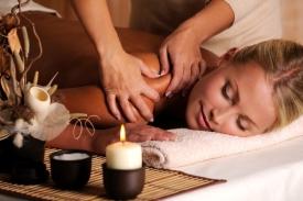 Masseur doing massage on female shoulder in the beauty salon